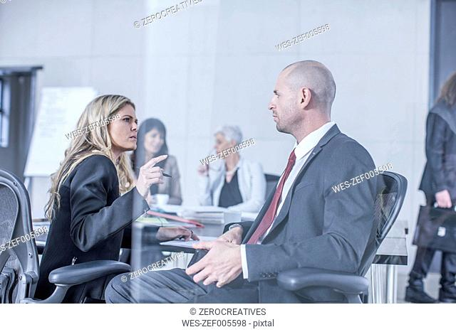 Businesspeople having meeting in board room