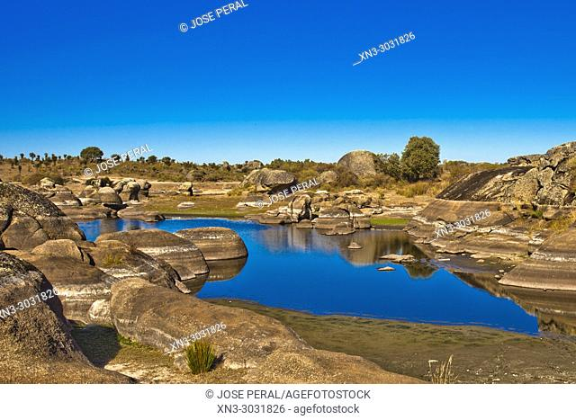 Pond with drought marks, Monolithic forms of granite worn by erosion, Los Barruecos, Natural park, Malpartida de Caceres, Caceres Province, Extremadura, Spain