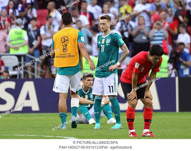 27 June 2018, Russia, Kazan: Soccer, FIFA World Cup, group F preliminary, Germany vs South Korea at the Kazan-Arena. Germany's Marco Reus (c) and Mario Gomez...