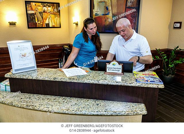 Florida, Kissimmee, Legacy Vacation Club Kissimmee, resort, hotel, timeshare program, concierge desk, guest services, lobby, man, woman, clerk, job, manager