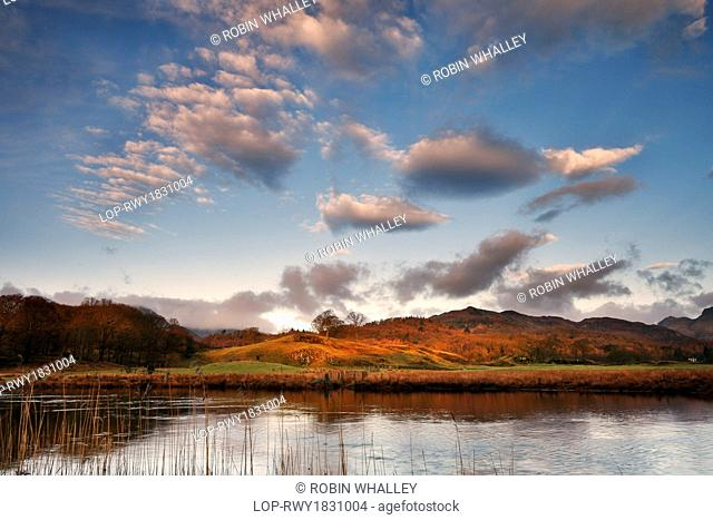 England, Cumbria, Elterwater. Early morning clouds above the still waters of the River Brathay