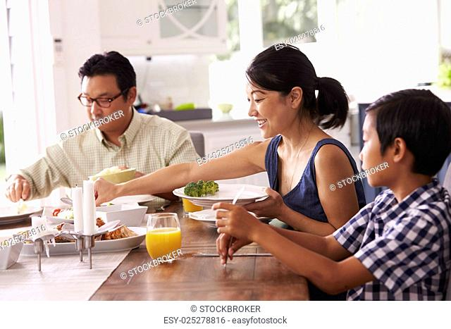 Family Eating Meal At Home Together