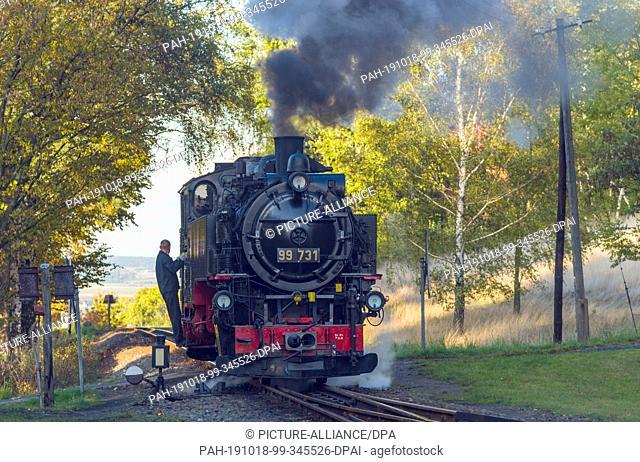 10 October 2019, Saxony, Jonsdorf: A steam locomotive of the Zittau narrow-gauge railway runs through the autumn landscape