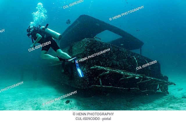Diver exploring wreck, Ko Racha Yai, Rawai, Phuket, Thailand