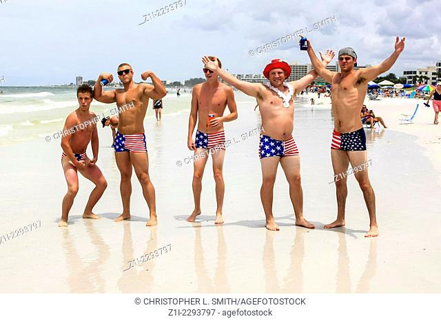 College guys wear patriotic Stars and Stripes swimwear on July 4th in Florida