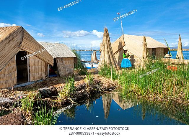 Villagers in traditional dress on the floating Islands in Lake Titicaca, Peru, South America