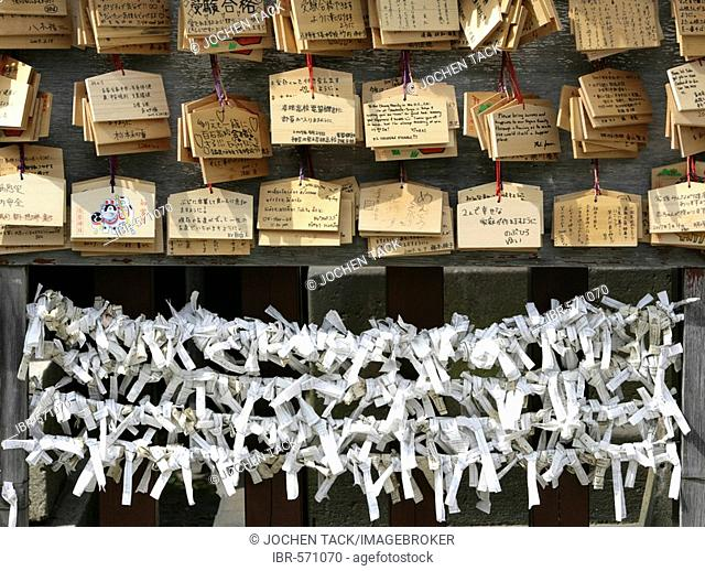 Japan, Tokyo: Shrine festival, called Matsuri. Asakusa Kannon Shrine Temple district. wooden board for list of things desired. Fortune papers