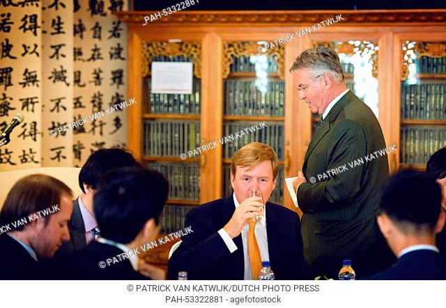 King Willem-Alexander (C) and Guus Hiddink (R) at the temple at the Dongguk University for an seminar about creative economy in Seoul, South Korea