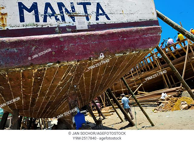 The stern of a traditional fishing wooden vessel is seen being repaired in an artisanal shipyard on the beach in Manta, Ecuador, 9 September 2012