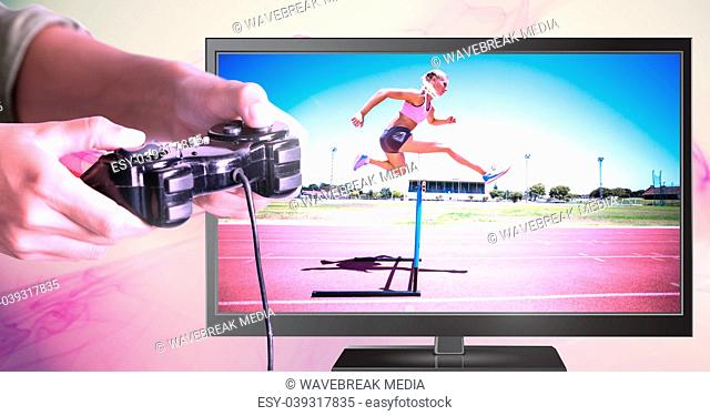 Hands holding gaming controller with hurdle sports jumper on television
