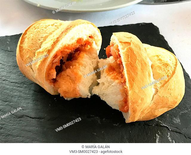 Pozas: traditional bread filled with tomato and tuna, typical from Colmenar de Oreja, Comunidad de Madrid, Spain