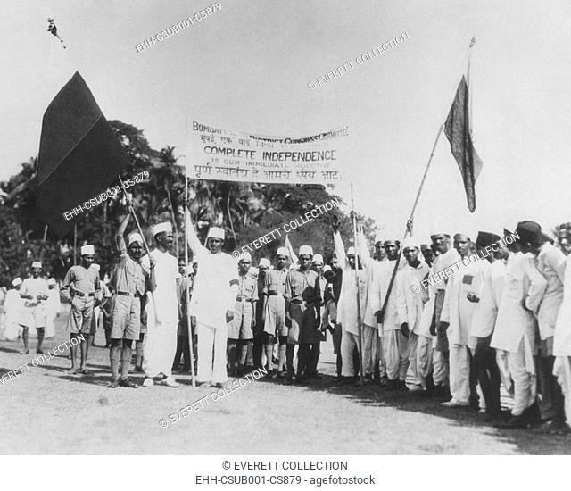'Satyagrahi' volunteers in Bombay (Mumbai) salute the National Congress flag. India, May 1930. The term 'satyagraha' was developed by Mahatma Gandhi
