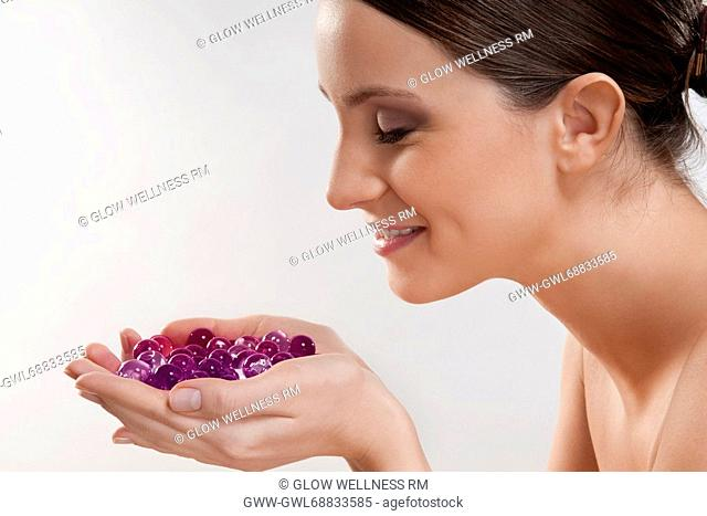 Woman smelling bath beads