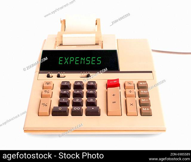 Old calculator showing a text on display - expenses