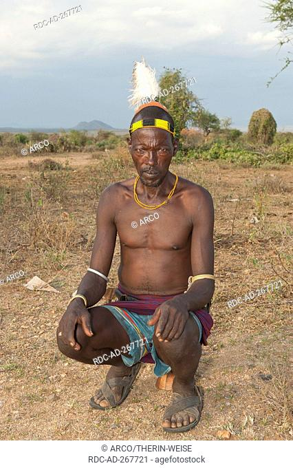 Hamar warrior with traditional hairstyle and feather, Omo river valley, Southern Ethiopia
