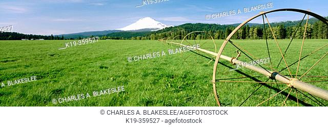 Irrigation wheel and Mount Adams, near Trout Lake. Klickitat County, Washington. USA