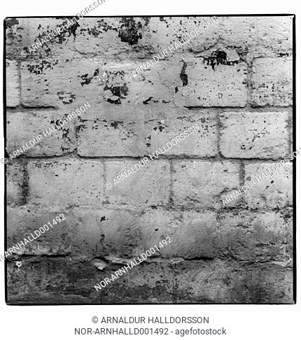 An old and faded brick wall