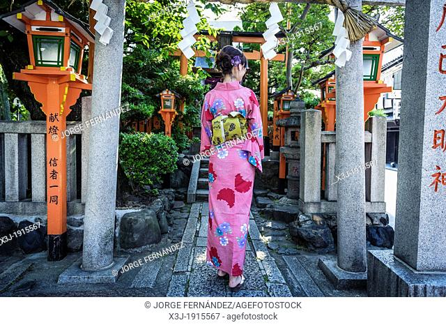 Tourist dressed with kimono on the streets of Kyoto, Japan, Asia