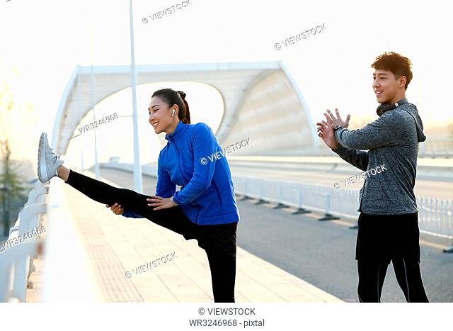 Young couples outdoor exercise