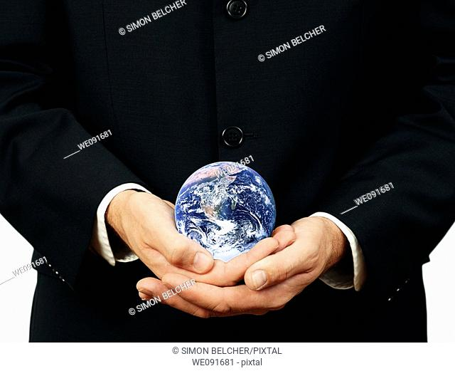 Businessman Holding Planet Earth, Close Up