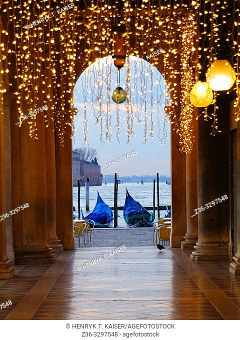 St Mark s Square and gondolas before sunrise in carnaval decoration, Venice, Italy