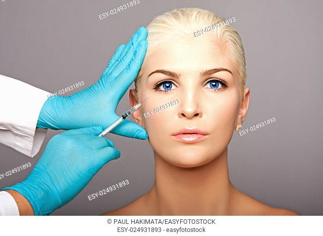 Beautiful face of young woman for Aesthetics facial skincare concept anti-wrinkle botox restylane injection by cosmetic plastic surgeon beautician