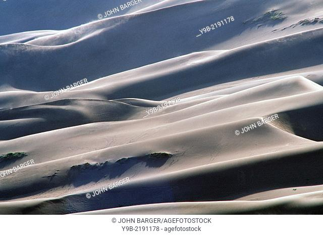 Sunrise light defines layers and textures of dunes at Great Sand Dunes National Park, Colorado, USA