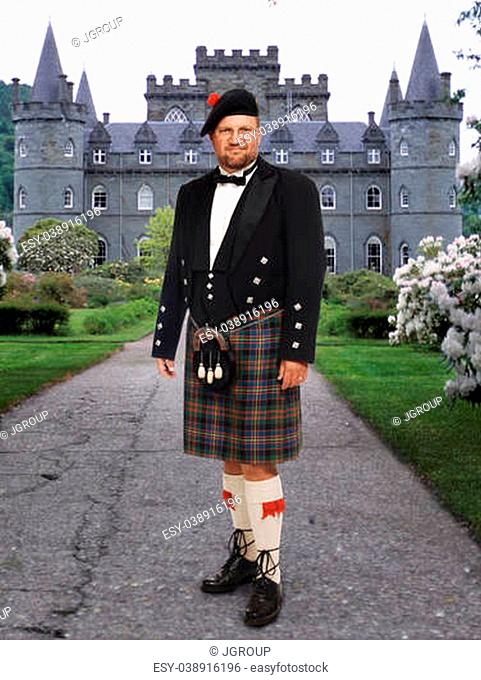 Scottish highland man in kilt in front of Inverary Castle