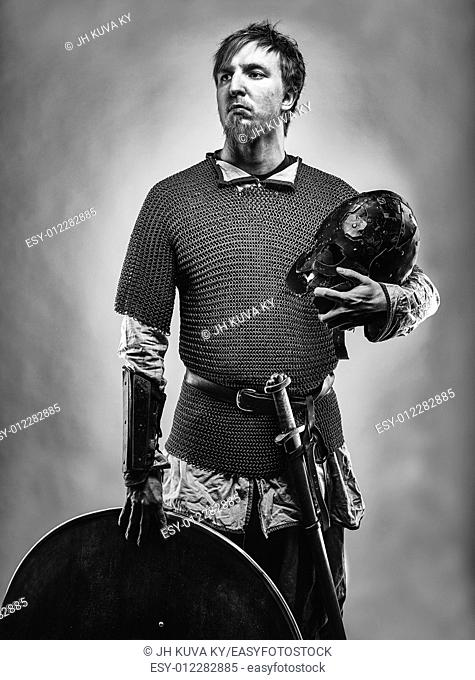 Medieval knight wearing a chainmail, black and white image