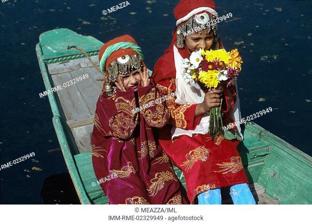 Srinagar - Dal lake, girls on Shikara Kashmir, India, Asia