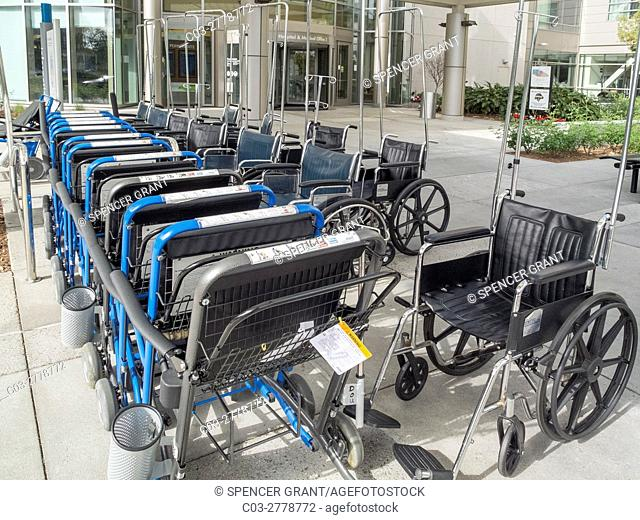 An organized group of wheelchairs is available for patients at a health medical organization (HMO) hospital in Irvine, CA