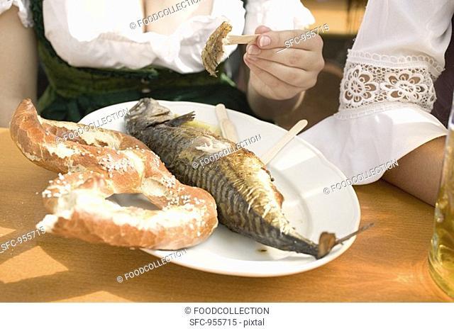 Steckerlfisch fish on stick & pretzel Oktoberfest, Munich