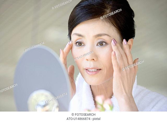 Japanese Woman Looking in Mirror