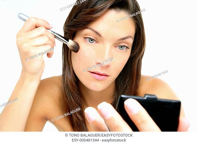 Beautiful portrait of woman makeup with brush over white