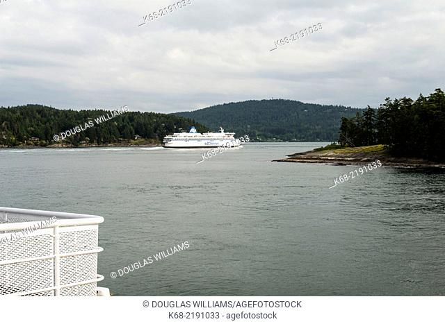 A BC Ferries boat enters Active Pass, Gulf Islands, British Columbia, Canada