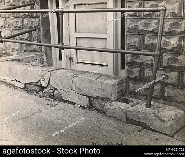 Crumbling concrete at cellar at Washington Terrace. Cincinnati, Ohio. United States. Farm Security Administration (Sponsor) Mydans, Carl (Photographer)