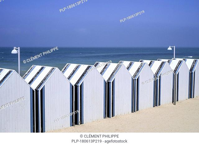 Row of decorated beach cabins at seaside resort Yport along the North Sea coast, Normandy, Seine-Maritime, Côte d'Albâtre, France