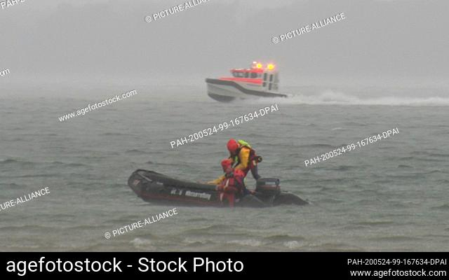 23 May 2020, Bavaria, Chiemsee: Boats of the water rescue service are on duty on the Chiemsee during storms. 22 people have been rescued from Chiemsee during a...