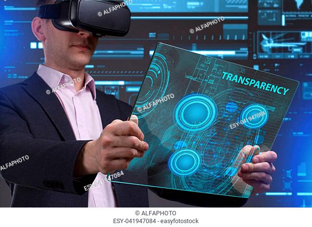Business, Technology, Internet and network concept. Young businessman working in virtual reality glasses sees the inscription: Transparency