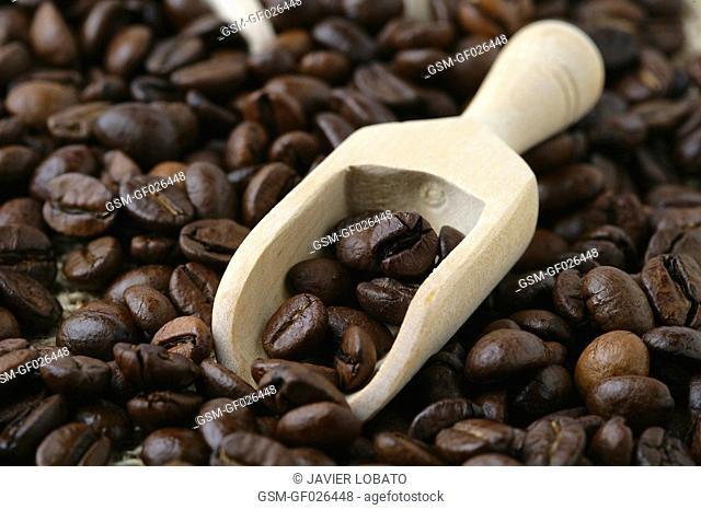 Natural coffee beans covering the whole image with sack-cloth