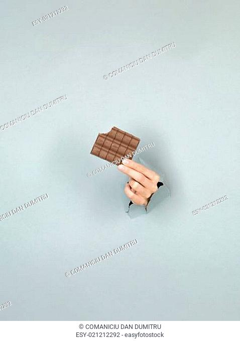 female hand holding delicious chocolate