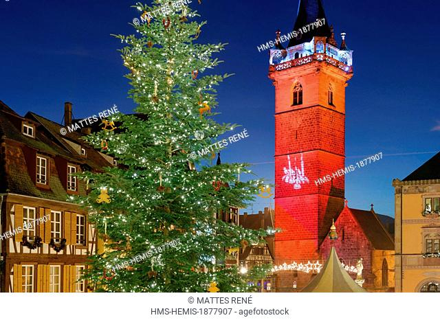 France, Bas Rhin, Obernai, Christmas market on market square, the chapel tower and the town hall