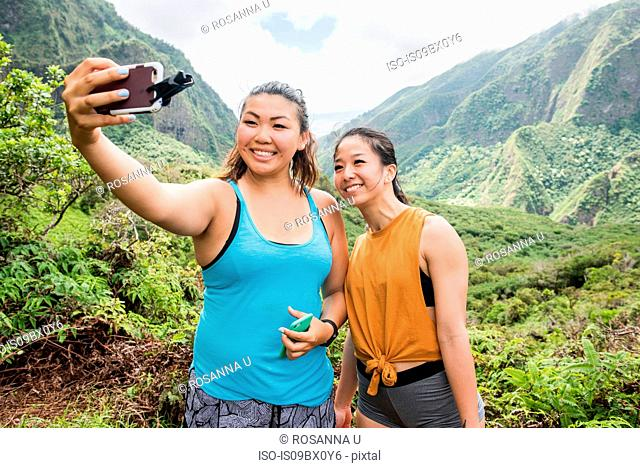Hikers taking selfie in rainforest, Iao Valley, Maui, Hawaii