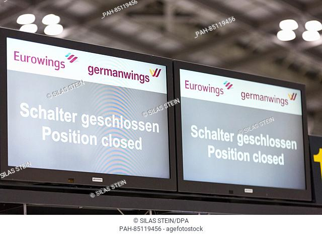 A bilingual German-English Eurowings and Germanwings monitor notifies passengers of a close check-in desk in the airport in Stuttgart, Germany, 27 October 2016