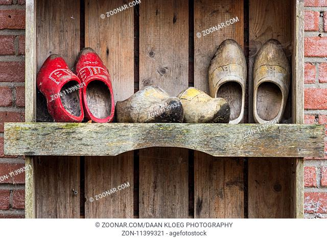 Giethoorn, The Netherlands - November 11, 2016: Three pair of wooden shoes in the small town of Giethoorn, Overijssel