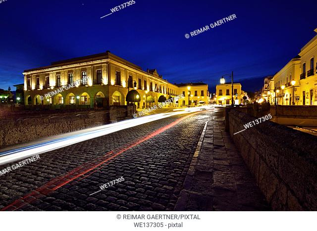 Car head and tail light trails at twilight on the Puente Nuevo bridge and Plaza Espana in Ronda Spain