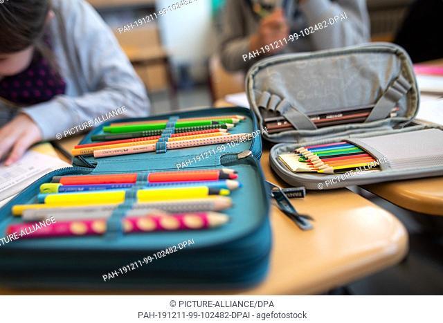 10 December 2019, Baden-Wuerttemberg, Stuttgart: Pencil cases lie on a table in an elementary school. Photo: Sebastian Gollnow/dpa