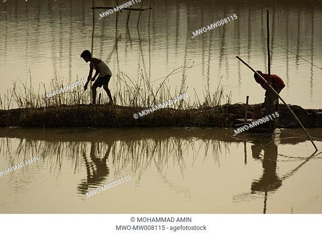 Villagers fishing in the flood waters at Kapasia, Gazipur, Bangladesh July 13, 2007