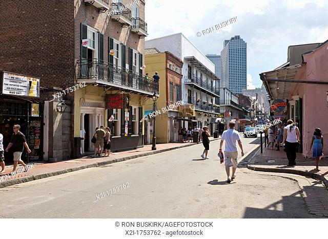 Tourists on Bourbon Street in the French Quarter of New Orleans, LA