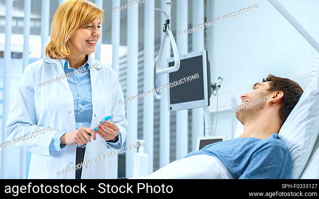 Doctor visiting a patient lying in bed